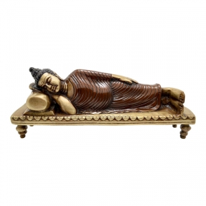 Reclining Brass Buddha Statue lying on bed