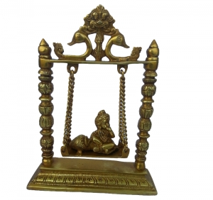 Baby Krishna eating butter statue on swing